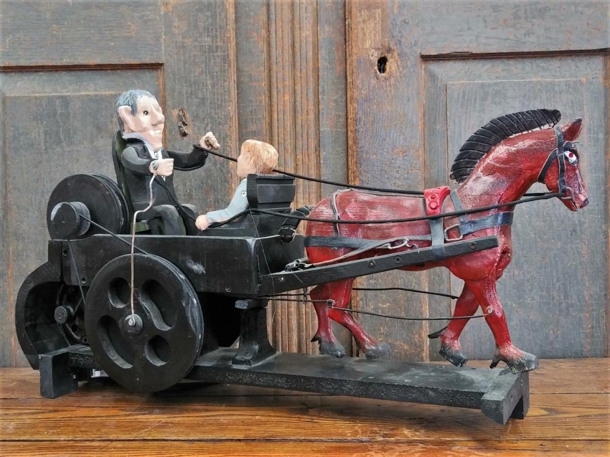 Folk art sculpture with horse 1