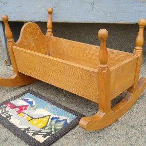 Little cradle and hooked rug