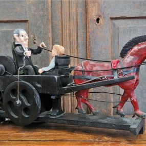 Folk art sculpture with horse